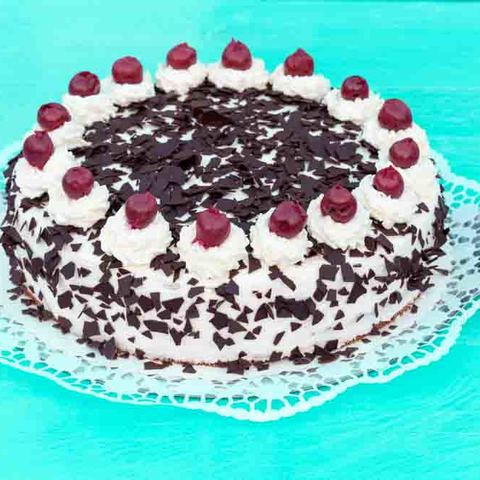Black Forest cake on turquoise wood